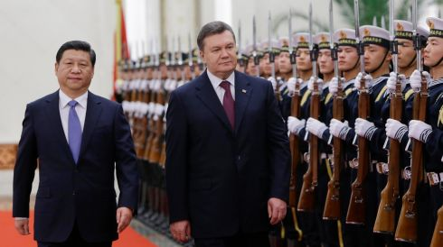 Ukrainian president Viktor Yanukovich (centre) inspects an honour guard at the Great Hall of the People in Beijing, China, with Chinese president Xi Jinping on December 5th, 2013, as protests against his stance regarding the EU continue at home. Photograph: Jason Lee/Reuters