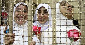Women who were found guilty of obstructing traffic during a pro-Islamist protest in October smile during their appeal hearing at a court in the Egyptian city of Alexandria last Friday. Photograph: Reuters