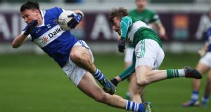 Eamon Fennell of St Vincent's evades the challenge from Portlaoise's Kieran Lillis during yesterday's Leinster football senior club championship final at  O'Connor Park, Tullamore, Co Offaly. Photograph: Inpho