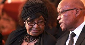 Winnie Madikizela-Mandela with South African president Jacob Zuma at a prayer service for former president Nelson Mandela. Photograph: Joao Silva/The New York Times