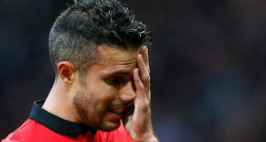 Manchester United's Robin van Persie reacts after losing to Newcastle United on Saturday.