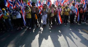 Anti-government protesters hold Thai national flags during a rally on a main road leading towards the Government House in Bangkok. Photograph: Chaiwat Subprasom/Reuters