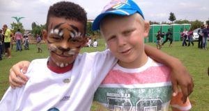 Two boys at the Mzimhlophe gathering, which drew about 1,000 black, white and mixed race children