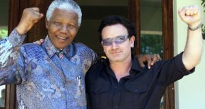 Nelson Mandela with Bono in 2002. 'I, like everyone else, was mesmeri z sed by his deft manoeuvering as leader of South Africa,' says the U2 frontman. Photograph: AP Photo/Juda Ngwenya