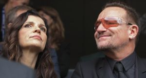 Bono and his wife Ali Hewson attend the official memorial service for former South African President Nelson Mandela at FNB Stadium today. Photograph: Chip Somodevilla/Getty Images
