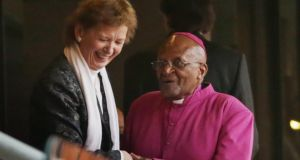 Former President Mary Robinson  and Archbishop Emeritus Desmond Tutu arrive for the official memorial service for former South African President Nelson Mandela. Photograph:  Chip Somodevilla/Getty Images