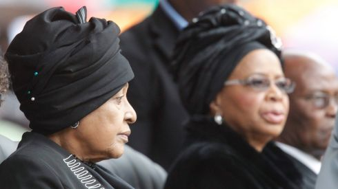 Nelson Mandela's former wife, Winnie Mandela (L), and Graca Machel (R), his widow, attend the official memorial service for the late South African president. The Nobel Peace Prize winner died at the age of 95 on December 5th.  Photograph: EPA/Kim Ludbrook
