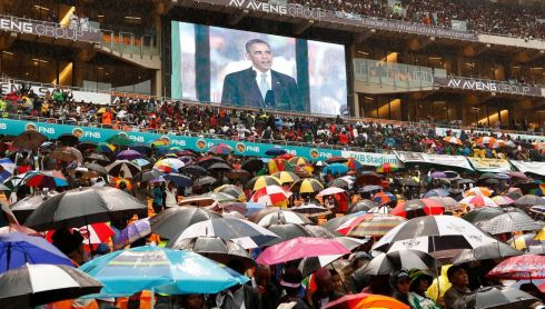 South Africans brave the rain as they listen to President Barack Obam. Photograph: Reuters/Kevin Lamarque