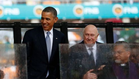 Former South African president F.W. de Klerk (C) watches as Barack Obama prepares to speak. Photograph: Reuters/Kevin Lamarque