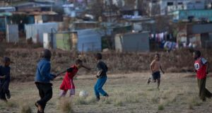 Children playing football in Soweto. What has changed for them since the end of apartheid? Photograph: AFP/Getty Images
