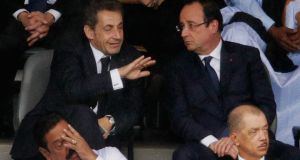Nicolas Sarkozy and François Hollande at the official memorial service for Nelson Mandela  in Johannesburg. Photograph: Chip Somodevilla/Getty Images