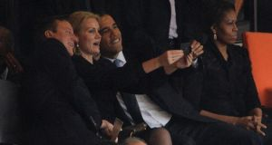 British prime minister David Cameron, Danish prime minister Helle Thorning-Schmidt and US president Barack Obama pose for a 'selfie' at Nelson Mandela's memorial service today.