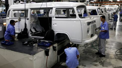 Workers on the assembly line of the VW plant in Sao Bernardo do Campo. It is the last plant to produce the Kombi globally and has been doing so for 56 years.