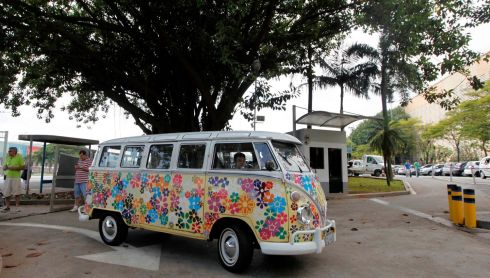 A customized Volkswagen Kombi minibus arrives to a Kombi fan club meeting. Higher manufacturing costs and increase in production time due to new auto regulations, which will require anti-lock brake systems and air bags in all cars produced in Brazil from 2014, contributed to its decision to stop the production of the Kombi, according to the company.