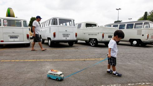 A boy pulls along his Volkswagen Kombi toy during a Kombi fan club meeting in Sao Bernardo do Campo.