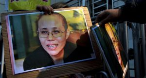A pro-democracy protester holds a portrait of Liu Xia, wife of jailed Nobel Peace Prize laureate Liu Xiaobo, during a protest to call for the freeing of Chinese dissidents  in Hong Kong. Photograph: Tyrone Siu/Reuters