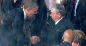 "US president Barack Obama  shakes hands with Cuban president Raul Castro during the memorial service for Nelson Mandela. Florida congresswoman Ileana Ros-Lehtinen, a Republican, called the gesture ""nauseating"". Photograph: Chip Somodevilla/Getty Images"