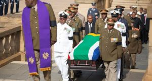Military officers carry the coffin of Nelson Mandela to the Union Buildings marking the start of the three-day lying in state. Photograph: EPA/Marco Longari/Pool