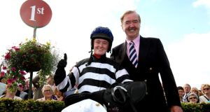 Jane Mangan with winning trainer Dermot Weld celebrates her victory in Galway last year. Photograph: INPHO/Lorraine O'Sullivan