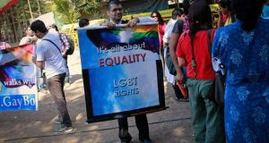 A gay rights activist in Mumbai folds a banner at a protest organised against the Supreme Court's order on gay, on Wednesday.  Photograph: Danish Siddiqui/Reuters