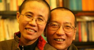 Jailed Nobel Prize winner Liu Xiaobo and his wife Liu Xia pose in this undated photo released by his family. Photograph: handout from Reuters
