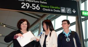 Mary Manning, Liz Deasy and Karen Gearon at Dublin Airport on Sunday pripor to their departure for South Africa, where they took part in a press conference on Wednesday given by the Cosatu trade union federation. Photograph: Eric Luke