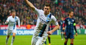 Manchester City's James Milner  Manchester City celebrates scoring the third goal against Bayern Munich. Photograph: Martin Rose/Getty Images    MUNICH, GERMANY - DECEMBER 10: James Milner of Manchester City celebrates scoring their third goal during the UEFA Champions League Group D match between FC Bayern Muenchen and Manchester City at the Allianz Arena December 10, 2013 in Munich, Germany. (Photo by Martin Rose/Bongarts/Getty Images)