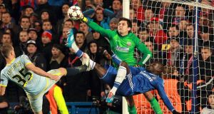 Chelsea's Demba Ba (right) has a shot stopped by Steaua Bucurest goalkeeper Ciprian Tatarusanu as Pantelis Kapetanos attempts a challenge  during the  Champions League Group E match at Stamford Bridge.