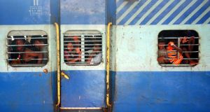Jammed in: commuters in India. Photograph: Sanjay Kanojia/AFP/Getty