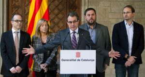 Catalonia's president Artur Mas, with other regional party leaders, speaks during a news conference on Thursday announcing the date for a referendum on Catalan independence referendum. Photograph: Reuters