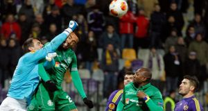 Maribor's goalkeeper Jasmin Handanovic makes a decisive save under the chyallenge from  Wigan's Jean Beausejour during their  Group D Europa League match in Maribor, Slovenia.  Photograph: AP Photo