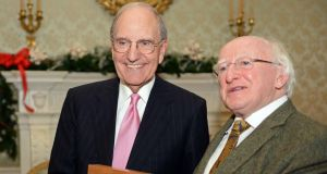 President Michael D Higgins  presents former US senator George Mitchell with a Presidential Distinguished Service Award at Áras an Uachtaráin yesterday.   Photograph: Eric Luke