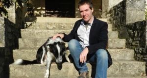 Irish emigrants, both recent and those who have lived abroad for decades, have been keeping a close eye on the bailout story through Irish media online as it unfolded. Above is Eamon O'Hara  at home  near Cahors, southwest France with dog Filou.