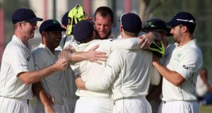 Ireland's man-of-the-match  John Mooney is congratulated in Dubai. Photograph: Barry Chambers/Inpho