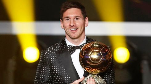 Fifa World Player of the Year 2012 Lionel Messi of Argentinas in his polka-dot number with the Ballon d'Or trophy in Zurich in January. Photograph: Michael Buholzer/Reuters