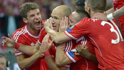 Arjen Robben (second left) celebrates with team-mates Thomas Mueller (left) and Bastian Schweinsteiger (31), as , Franck Ribery offers some words of wisdom in his ear. Photograph: Bob Thomas/Popperfoto/Getty Images