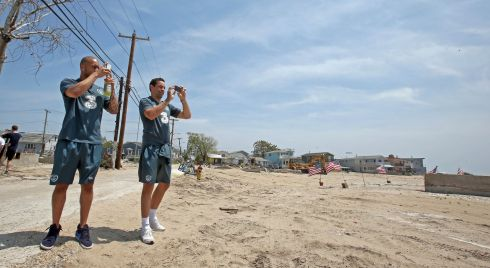 Republic of Ireland goalkeepers Darren Randolph and David Forde take pictures of Breezy Point in New York in June after Hurricane Sandy hit the American east coast. PHotograph: Donall Farmer/Inpho