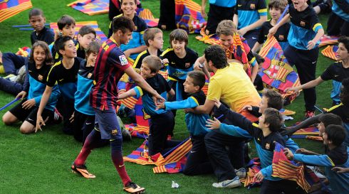 FC Barcelona's superstar signing from Santos,  Neymar da Silva Santos Junior, meets young supporters during his presentation at Camp Nou stadium. Photograph: Josep Lago/AFP/Getty Images