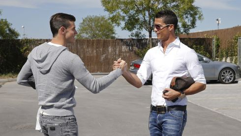 Gareth Bale (left) and Cristiano Ronaldo of Real Madrid shake hands before a training session at Valdebebas training after the Welshman's €100m move to Real Madrid from Spurs.  Photograph: Helios de la Rubia/Real Madrid via Getty Images