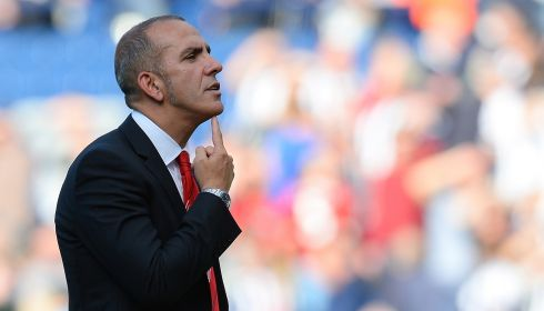 Sunderland manager Paolo Di Canio tells the fans to keep their chins up after defeat to West Bromwich Albion at The Hawthorns. Photograph: Andrew Yates/AFP/Getty Images