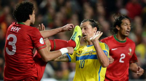 Sweden's forward Zlatan Ibrahimovic dodges the boot of Portugal defender Pepe during the World Cup 2014 play-off  at the Luz stadium in Lisbon on November 15th. Photograph: Franciso Leong/AFP/Getty Images