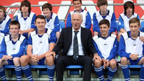 Former Republic of Ireland manager Giovanni Trapattoni alongside some ballboys ahead of the friendly with Wales in August. Photograph: Donall Farmer/Inpho
