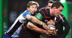Connacht's scrum half Kieran Marmion tackles  Toulouse's Louis Picamoles during last week's match  in Toulouse.