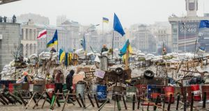 Anti-government protesters continue to fortify their barricades to block the police from forcing them out of Independence Square in Kiev yesterday. Photograph: Brendan Hoffman/Getty Images