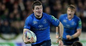Leinster's Brian O'Driscoll runs in to score a try against Northampton. Photograph: Tony Marshall/PA Wire