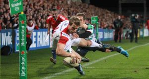 Ulster's Andrew Trimble scores a try against Treviso. Photograph: Darren Kidd/Presseye/Inpho