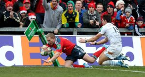 Munster's Keith Earls scores a try against Perpignan. Photograph: Dan Sheridan/Inpho