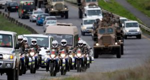 Military outriders ride past a village as they rehearse escorting the funeral cortege for former South African president Nelson Mandela in Mthatha,  Eastern Cape. Photograph: Siphiwe Sibeko/Reuters