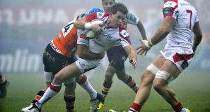 Craig Gilroy of Ulster is tackled by Benetton Treviso's Edoardo Gori. Photograph: Elena Barbini/Presseye/Inpho