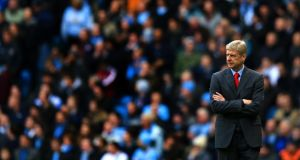 Arsene Wenger looks  on during Arsenal's 6-3 defeat to Manchester City at the Etihad Stadium. Photograph: by Richard Heathcote/Getty Image